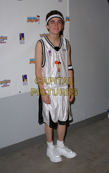 FRANKIE MUNIZ.2nd Annual Frankie Muniz HoopLA held at the Los Angeles Sports Arena in Los Angeles, California. Pokemon Trading Card Game hosts the celebrity basketball event to benefit Starlight Children's Foundation .14 March 2004.*UK Sales Only*.full length, full-length.www.capitalpictures.com.sales@capitalpictures.com.©Capital Pictures.