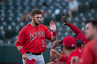 AZL Angels first baseman Brett Bond (10) is congratulated by his teammates after scoring a run during an Arizona League game against the AZL Indians 2 at Tempe Diablo Stadium on June 30, 2018 in Tempe, Arizona. The AZL Indians 2 defeated the AZL Angels by a score of 13-8. (Zachary Lucy/Four Seam Images)