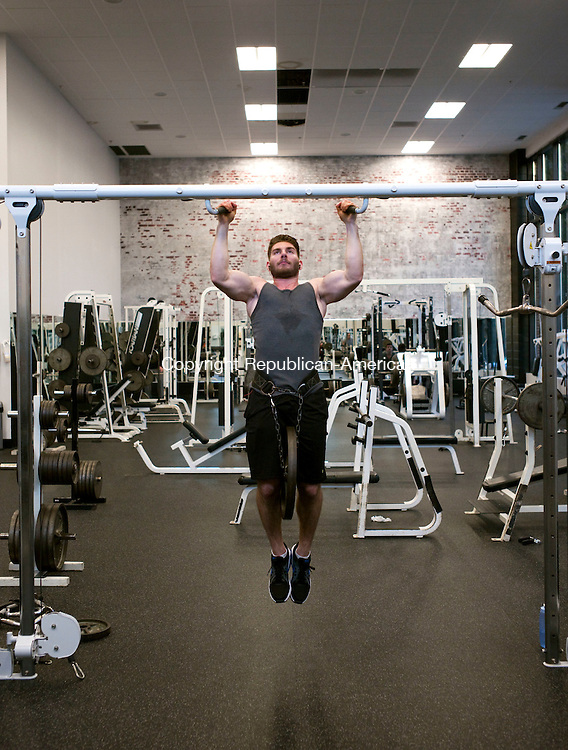 Middlebury, CT- 01 January 2016-010116CM03- Michael Cutrali of Middlebury works out at Catalyst Health & Fitness in Middlebury on Friday. Cutrali was one of the members who was starting the New Year by exercising at the club. Christopher Massa Republican-American