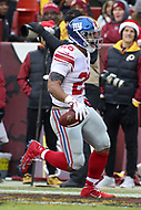 Landover, MD - December 9, 2018: New York Giants running back Saquon Barkley (26) celebrates after scoring a touchdown during the  game between New York Giants and Washington Redskins at FedEx Field in Landover, MD.   (Photo by Elliott Brown/Media Images International)