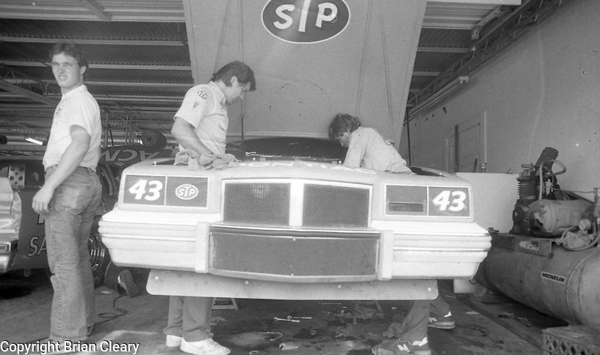 crewmen work on Richard Petty 43 Pontiac in garage Firecracker 400 at Daytona International Speedway in Daytona Beach, FL on July 4, 1983. (Photo by Brian Cleary/www.bcpix.com)