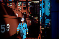 A crew member walks on the Mary Maersk, the largest container ship in the world.