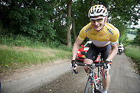 Andr&eacute; Greipel (DEU/Lotto-Soudal) in the leaders jersey,  returning with a smile to the peloton up a climb after a nature break<br /> <br /> stage 3: Buchten-Buchten (190km)<br /> 29th Ster ZLM Tour 2015