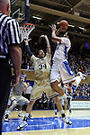 31 December 2014: Duke's Jahlil Okafor (right) shoot over Wofford's Lee Skinner (34). The Duke University Blue Devils hosted the Wofford College Terriers at Cameron Indoor Stadium in Durham, North Carolina in a 2014-16 NCAA Men's Basketball Division I game.