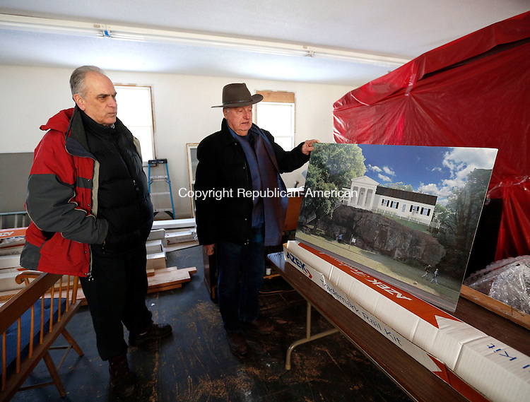 Woodbury, CT- 13 February 2015-021315CM08-<br /> Wayne Anderson, president of the King Solomon's Temple Organization, left, and Steve Lewis, member of the board of directors at the temple, talk display a rendition of the King Solomon's Lodge No. 7 in Woodbury on Friday. The rendition illustrates the exterior of the lodge following a renovation project that has begun there.   Christopher Massa Republican-American