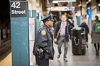 An NYPD officer on his post in the New York subway in Times Square on Tuesday, March 22, 2016. Security in New York has been heightened in the wake of the terrorist bombings in Brussels, Belgium. (© Richard B. Levine)