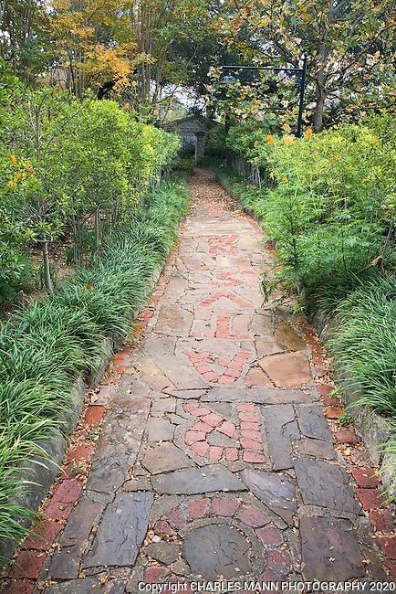 "A pathway which has an inscription in Latin that says  ""May the little garden flourish deducated to Ina in the year of the  reighn of Edward the eighth"" made by Douglas Chandor in his garden in Weatherford, Texas."