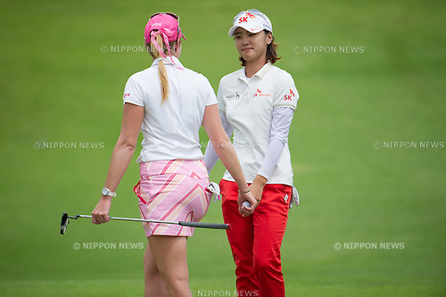 (L-R) Paula Creamer (USA), Na Yeon Choi (KOR),.MARCH 3, 2013 - Golf :.Na Yeon Choi of South Korea shakes hand with Paula Creamer of the United States during the final round of the the HSBC Women's Champions golf tournament at Sentosa Golf Club in Singapore. (Photo by Haruhiko Otsuka/AFLO)