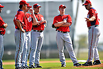 20 February 2011: A group of Washington Nationals pitchers listen to instruction during Spring Training at the Carl Barger Baseball Complex in Viera, Florida. Mandatory Credit: Ed Wolfstein Photo