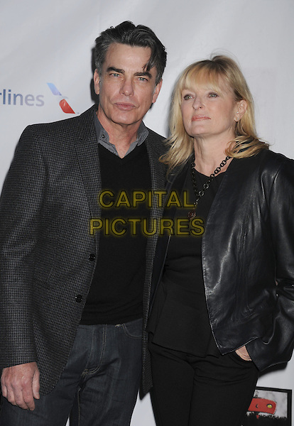Peter Gallagher, Paula Gallagher.The US-Ireland Alliance Pre-Academy Awards Gala Held At Bad Robot, Santa Monica, California, USA..February 21st, 2013.half length black jacket top grey gray suit jacket married husband wife .CAP/ROT/TM.©Tony Michaels/Roth Stock/Capital Pictures