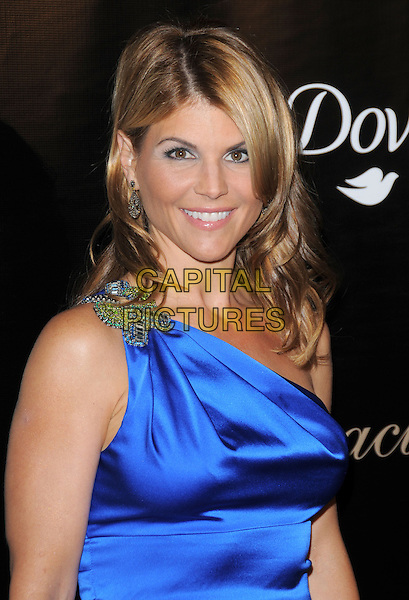 LORI LOUGHLIN.The Gracie Awards Gala held at The Beverly Hilton Hotel in Beverly Hills, California, USA..May 25th, 2010           .half length blue one shoulder silk satin dress silver brooch.CAP/RKE/DVS.©DVS/RockinExposures/Capital Pictures.