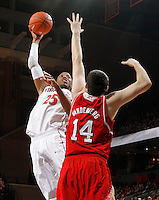 Virginia forward Akil Mitchell (25) shoots over North Carolina State center Jordan Vandenberg (14) during the game Saturday in Charlottesville, VA. Virginia defeated NC State 58-55.
