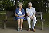 Older couple sitting on a bench in the park,