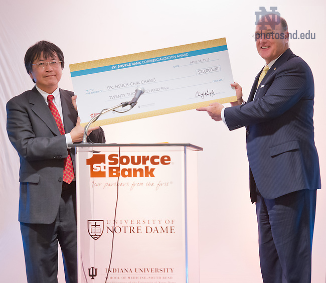 Apr. 15, 2013; College of Engineering professor Hsueh-Chia Chang receives a ceremonial check from Chris Murphy, Chairman and CEO of 1st Source Bank after winning the 2013 1st Source Bank Commercialization Award...Photo by Matt Cashore/University of Notre Dame