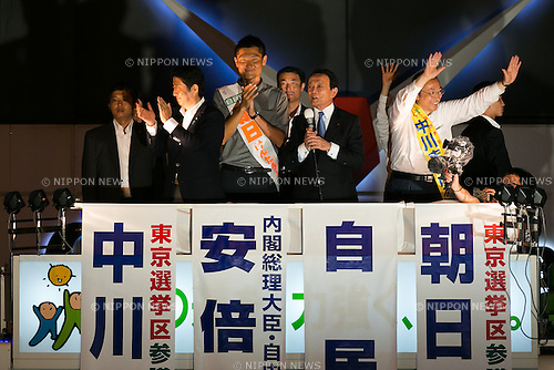 (L to R) Shinzo Abe, leader of the Liberal Democratic Party and Prime Minister of Japan, LDP candidate Kentaro Asahi, Finance Minister Taro Aso and LDP candidate Masaharu Nakagawa, campaign in Akihabara on July 9, 2016, Tokyo, Japan. Abe delivered his last campaign speech before the July 10th House of Councillors elections. (Photo by Rodrigo Reyes Marin/AFLO)
