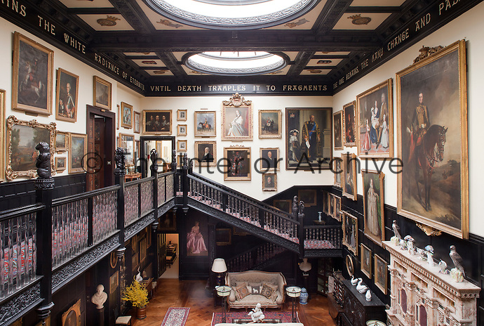 A motto from Shelly's Adonais encircles the staircase hall which was created by the seventh Earl. The fireplace made of English alabaster can be seen on the right