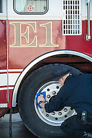 STAFF PHOTO ANTHONY REYES &bull; @NWATONYR<br /> Colton Harris, engineer with the City of Tontitown Fire Department, dries off a wheel Monday, Dec. 8, 2014 while washing engine one at the station in Tontitown. The department will be having a special event where children can meet Santa, eat cookies and hot chocolate and explore the fire trucks Saturday, Dec. 13 at the station.