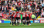 Players team together during the League One match at Bramall Lane Stadium, Sheffield. Picture date: September 17th, 2016. Pic Simon Bellis/Sportimage