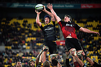 Mark Abbott beats Scott Barrett to lineout ball during the Super Rugby match between the Hurricanes and Crusaders at Westpac Stadium in Wellington, New Zealand on Saturday, 15 July 2017. Photo: Dave Lintott / lintottphoto.co.nz