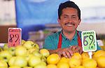 Hispanic man working at a fruit stand
