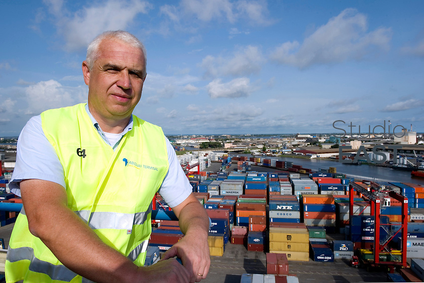 Abidjan Terminal Operations Manager Roland Grard poses for a photograph overlooking Abidjan Container Terminal, in Abidjan, Ivory Coast, on November 3, 2010. Roland Grard works for APM, a part of Danish conglomerate Maersk. Photo by Lucas Schifres/Pictobank