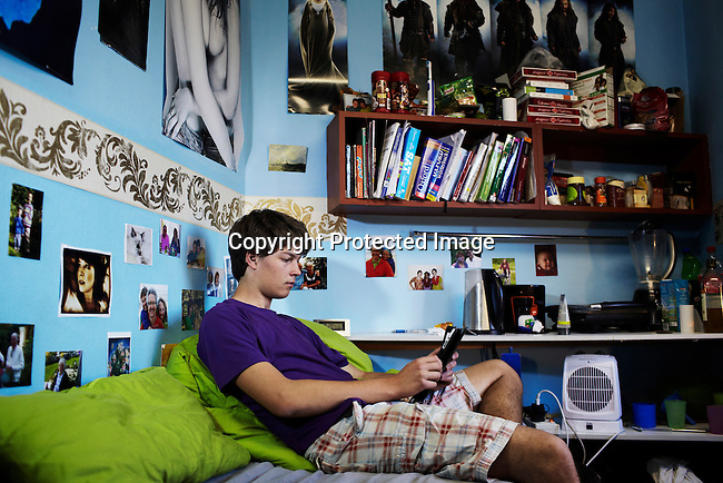 MBABANE, SWAZILAND - AUGUST 6:  Julian Storch, age 19, a German student in his residence room at Waterford Kamhlaba United World College of Southern Africa, a secondary school on August 6, 2013 in Mbabane, Swaziland.  Julian is one of the few students from Germany.  Others are from Finland, Norway, and Portugal etc. Julian grew up with a family with siblings and the family also took care of children and youth. He has a passion for children and likes to work in rural areas with children. (Photo by: Per-Anders Pettersson)