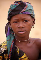 Dan Gaya, Niger, West Africa.  Young Hausa Girl with Facial Scarification as Tribal Identify Marks. Portraits of Hausa ethnic group, men, women, children, of Niger.  Tell us what you need.