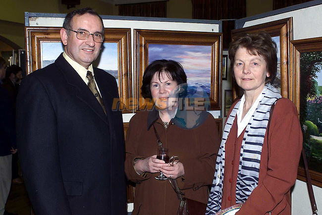 Des and Bridie Magee and Margret Mallon from Ardee at the art exhibition in Castlebellingham..Picture:Newsfile..Camera:   DCS620X.Serial #: K620X-00546.Width:    1728.Height:   1152.Date:  25/11/00.Time:   22:12:06.DCS6XX Image.FW Ver:   3.2.1.TIFF Image.Look:   Product.Sharpening Requested: Yes.Tagged.Counter:    [2058].Shutter:  1/60.Aperture:  f8.0.ISO Speed:  400.Max Aperture:  f2.8.Min Aperture:  f22.Focal Length:  28.Exposure Mode:  Manual (M).Meter Mode:  Color Matrix.Drive Mode:  Continuous High (CH).Focus Mode:  Continuous (AF-C).Focus Point:  Center.Flash Mode:  Normal Sync.Compensation:  +0.0.Flash Compensation:  +0.0.Self Timer Time:  10s.White balance: Custom.Time: 22:12:06.550.