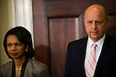 Washington, D.C. - January 5, 2007 -- United States Secretary of State Condoleezza Rice and Director of National Intelligence (DNI) John Negroponte listen as U.S. President George W. Bush announces Mike McConnell will replace Negroponte as DNI. Negroponte will become the Deputy Secretary of State under Condoleezza Rice. <br /> Credit: Jay L. Clendenin - Pool via CNP
