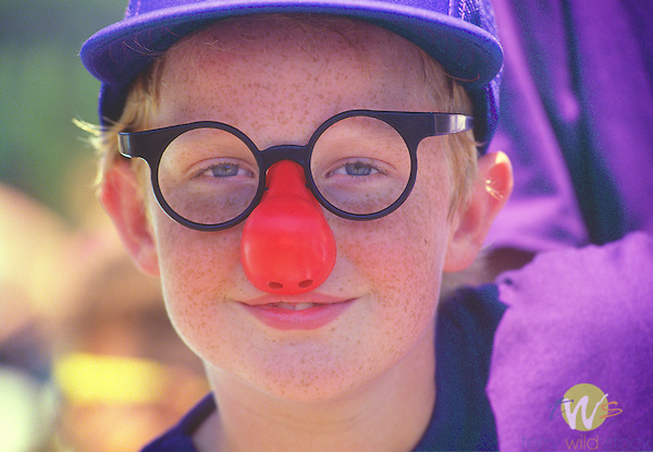 Camp Dost summer camp for children with cancer. Boy with clowns nose.