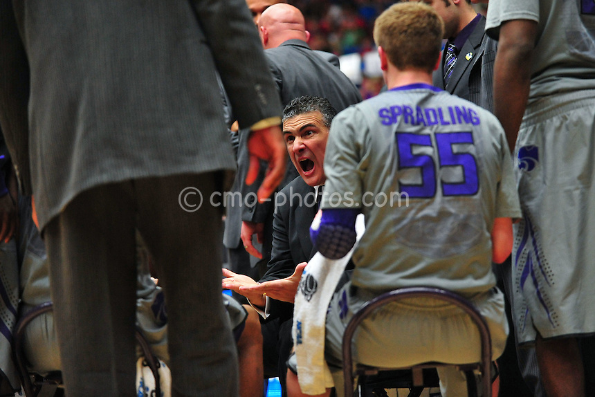 Mar 17, 2011; Tucson, AZ, USA; Kansas State Wildcats head coach Frank Martin yells at his team during a timeout in the second half of a game against the Utah State Aggies in the second round of the 2011 NCAA men's basketball tournament at the McKale Center.  The Wildcats won 73-68.