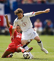 Panama's Engin Mitre attempts a tackle on USA's John O'Brien during first half action between the United States and Panama in the finals of the CONCACAF Gold Cup at Giant's Stadium, East Rutherford, NJ, on July 24, 2005.