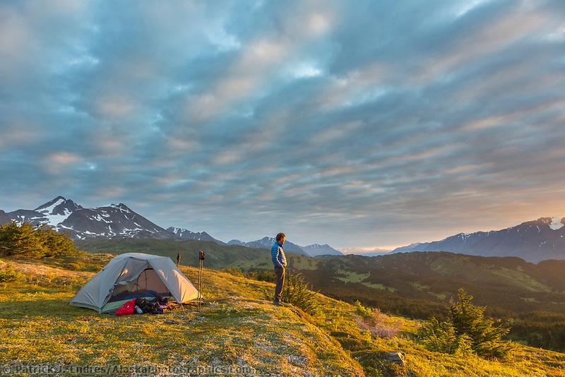 Hiker and tent camp near the Lost Lake Trail, Chugach National Forest, Seward, Alaska.
