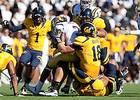 Mike Mohamed brings down Josh Smith. The California Golden Bears defeated the UCLA Bruins 35-7 at Memorial Stadium in Berkeley, California on October 9th, 2010.