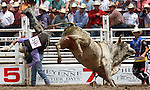 PRCA cowboy Shawn Proctor gets sent out the back door  as bullfighter Jeremy Sparks looks on during final round bullriding action at the 112th annual Cheyenne Frontier Days Rodeo July 27, 2008 in Cheyenne, Wyoming.