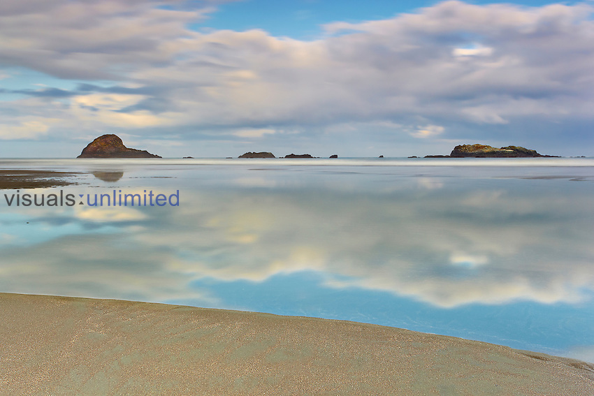 A very low tide created a still pool that extended out to the breakers on this beach near Trinidad, Northern California, USA.
