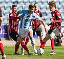 Dundee's Luka Tankulic tries to get away from St Johnstone's Gary Miller and St Johnstone's Murray Davidson.