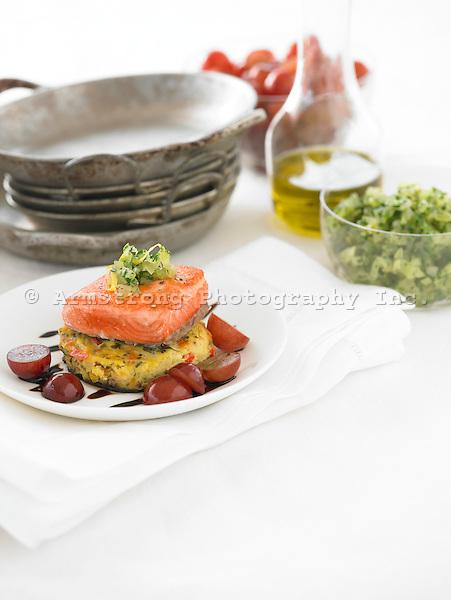 Salmon with polenta cake, grapes, sauteed onion