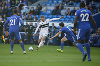 Andre Schurrle of Fulham (C) scores the opening goal while closely marked by Harry Arter of Cardiff City (3rd L) during the Premier League match between Cardiff City and Fulham FC at the Cardiff City Stadium, Wales, UK. Saturday 20 October 2018