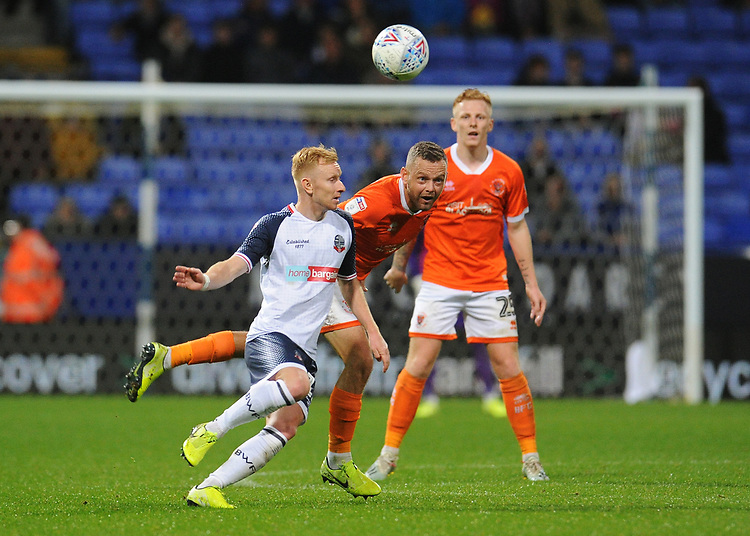 Blackpool's Jay Spearing vies for possession with Bolton Wanderers' Ali Crawford<br /> <br /> Photographer Kevin Barnes/CameraSport<br /> <br /> The EFL Sky Bet League One - Bolton Wanderers v Blackpool - Monday 7th October 2019 - University of Bolton Stadium - Bolton<br /> <br /> World Copyright © 2019 CameraSport. All rights reserved. 43 Linden Ave. Countesthorpe. Leicester. England. LE8 5PG - Tel: +44 (0) 116 277 4147 - admin@camerasport.com - www.camerasport.com