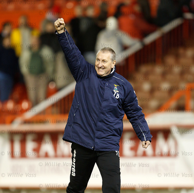 Terry Butcher salutes the travelling Caley fans with a clenched fist after dumping misery on Aberdeen boss Mark McGhee