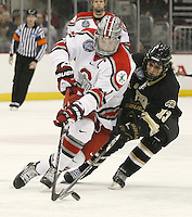 Ohio State's Ryan Dzingel (18) battles for the puck with Western Michigan's Chase Balisy (13) during a NCAA hockey game at Value City Arena, Friday, Feb. 15, 2013 in Columbus, Ohio. (Photo for the Dispatch by Mike Munden)