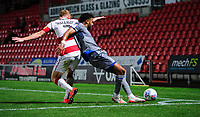 Lincoln City's Bruno Andradevies for possession with Doncaster Rovers' Brad Halliday<br /> <br /> Photographer Chris Vaughan/CameraSport<br /> <br /> EFL Leasing.com Trophy - Northern Section - Group H - Doncaster Rovers v Lincoln City - Tuesday 3rd September 2019 - Keepmoat Stadium - Doncaster<br />  <br /> World Copyright © 2018 CameraSport. All rights reserved. 43 Linden Ave. Countesthorpe. Leicester. England. LE8 5PG - Tel: +44 (0) 116 277 4147 - admin@camerasport.com - www.camerasport.com