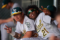 Oakland Athletics Jhonny Rodriguez (15) and Eric Marinez (21) during an instructional league game against the San Francisco Giants on October 12, 2015 at the Giants Baseball Complex in Scottsdale, Arizona.  (Mike Janes/Four Seam Images)