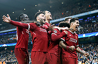 Liverpool's Roberto Firmino (right) celebrates with team-mates after scoring his side's second goal <br /> <br /> Photographer Rich Linley/CameraSport<br /> <br /> UEFA Champions League Quarter-Final Second Leg - Manchester City v Liverpool - Tuesday 10th April 2018 - The Etihad - Manchester<br />  <br /> World Copyright &copy; 2017 CameraSport. All rights reserved. 43 Linden Ave. Countesthorpe. Leicester. England. LE8 5PG - Tel: +44 (0) 116 277 4147 - admin@camerasport.com - www.camerasport.com