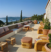 The east-facing main terrace overlooks the islet of Spetsopoula and is furnished with comfortable cane armchairs and foot stools