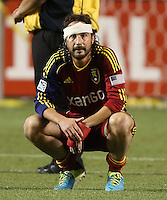 With a bandage on his head Ned Grabavoy #20 of Real Salt Lake watches D.C. United players celebrate their win over Real at the U.S. Open Cup Final on October 1, 2013 at Rio Tinto Stadium in Sandy, Utah. DC United beat Real Salt Lake 1-0 to win the championship.