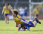 Sean Collins of Clare in action against David Murray of Roscommon during their National League game at Cusack Park. Photograph by John Kelly.