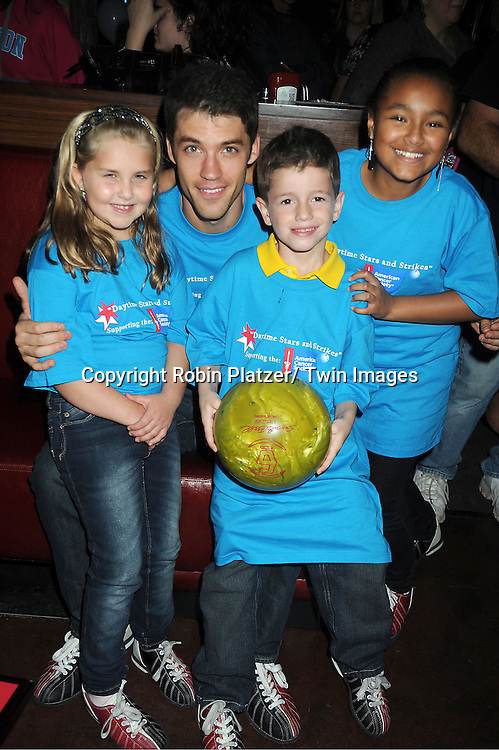 Stephanie Schmahl, David Gregory, Patrick Gibbons and Saoirse Scott attends the Daytime Stars and Strike Charity Event benefitting The American Cancer Society on October 7, 2012 at Bowlmor Lanes in Times Square in New York City.