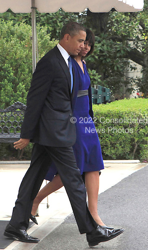United States President Barack Obama and First Lady Michelle Obama depart the White House for a trip to Boston, Massachusetts for a Boston Marathon Tragedy Memorial Service on April 18,2013. .Credit: Dennis Brack / Pool via CNP
